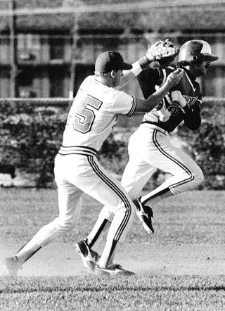 Runnin' Rebels infielder Matt Williams applies a tag to runner. Williams played third base in the major leagues for several years, and won a World Series with the Arizona Diamondbacks.