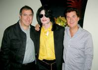 Kenny Ortega, Michael Jackson and Simon Fuller.