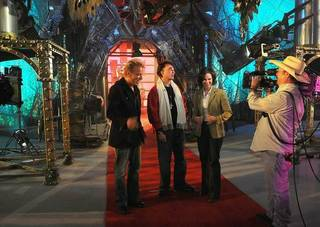 Siegfried & Roy and ABC anchor Elizabeth Vargas inside S&R's warehouse of magic tricks.