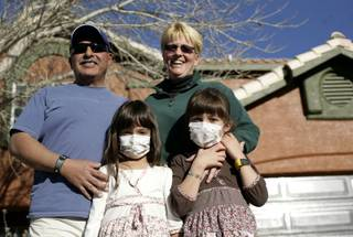 The Cerda family -- Chuck, Terri, Maggie and Molly -- stand in front of their home on Tuesday, which will be torn down and replaced as part of ABC's