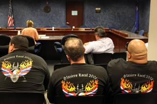 Union workers listen during a public forum on worker safety in Nevada during a Senate Committee on Commerce and Labor meeting at the Grant Sawyer Building in Las Vegas on Wednesday.