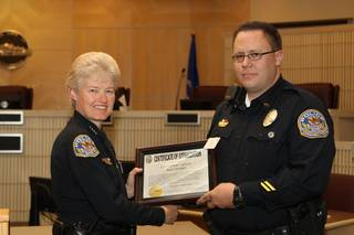 Corrections Officer Jed Robbins receives a Certificate of Appreciation, for coming to the aid of an inmate attempting suicide, Wednesday during the 6th Annual Commendation Award Ceremony.