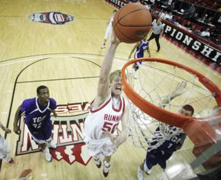 Utah center Luke Nevill dunks against TCU at the Mountain West Conference Basketball Championships Thursday, March 12, 2009.  Utah won the game 61-58 on a last-second three point shot.
