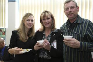 Postmaster Shirley Roland poses for a photograph with her husband, Mike, and daughter, Leslie, left, during her installment ceremony reception Thursday in Boulder City.