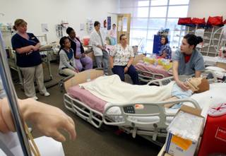Nursing student and respiratory therapist Jill Petersen, right, puts an oxygen mask on a medical mannequin during a Fundamentals Skills Lab at the Nevada State College in Henderson on Wednesday, March 11, 2009. Nevada State College was hitting 80 percent licensure examination pass rates in 2008. Graduates of two of Nevada's newest nursing schools have licensure examination pass rates hovering at around 60 percent, well below the standard 80 percent plus.