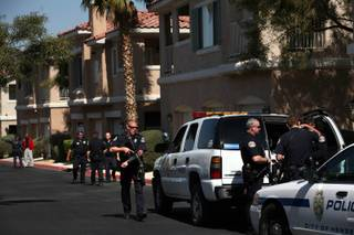 Henderson police respond to gunfire in the Bella Vista Condominiums in Henderson on Sunday afternoon.