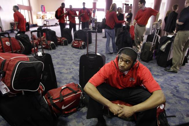Oscar Bellfield sits on his bag as the UNLV Rebels wait to check in at McCarran International Airport on Tuesday, March 16, 2010. The Rebels headed off to take on 9-seed Northern Iowa in Oklahoma City in the NCAA tournament.