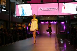 A model takes to the catwalk at the Barbie Fashion Show at Fashion Show Mall Saturday. All of the pieces were designed by students from the International Academy of Design and Technology of Las Vegas.