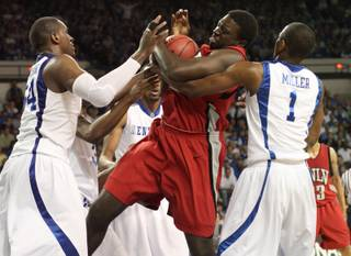 Brice Massamba battles for a rebound as UNLV takes on the Kentucky Wildcats in Lexington, Ky., Tuesday night in the first round of the NIT. The game was played in Memorial Coliseum.