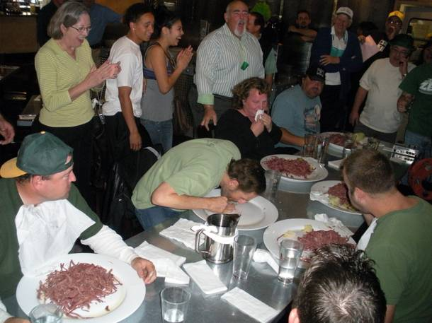 Eating contest winner Rob Koch licks his plate clean at a corned beef eating contest. Morrison went on the win second place in the contest.