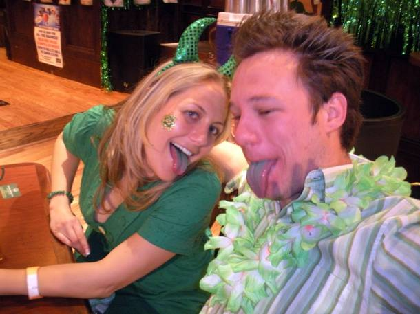 Las Vegas residents Jeanne Slingluff and Brian Evans show off their green-tinted tongues while celebrating St. Patrick's Day with green beer specials at McFadden's Tuesday.