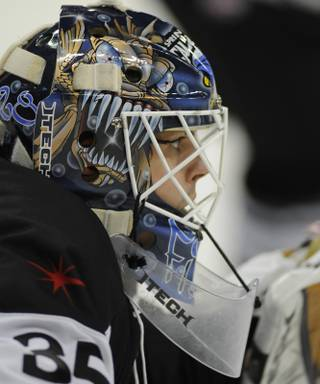 Las Vegas Wranglers goaltender Glenn Fisher closely watches a faceoff in his zone during the first period of play against the Phoenix Roadrunners at the Orleans Arena on Tuesday night. Fisher became the first Wranglers netminder to post back-to-back shutouts in franchise history with a 1-0 victory over the Roadrunners.