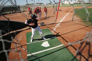 Southeast Technical and Career Center senior Chris Sambol works on his swing at practice.