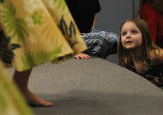Kiera Cronk, 3, leans in for a closer look at a Hawaiian dancer during a performance of the 2008 Na Hoku Hanohano Award winning recording artist Gary Haleamau at Elise Wolff Elementary School on Thursday night.