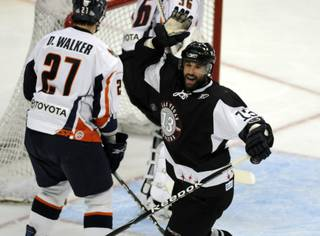 Las Vegas center Chris Ferraro celebrates scoring his 20th goal of the season during the second period against the Ontario Reign at the Orleans Arena on Friday night.