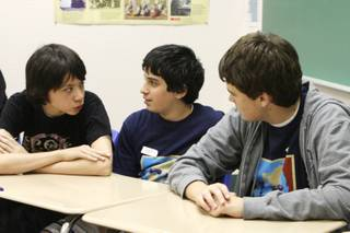 Freshmen, from left, Christopher Wang, Mex Asaf and Steven Gibson consult each other during their bonus question of the Latin Competitive Certamen during the third annual Convention of the Nevada Junior Classical League at The Meadows School on March 20, 2009.