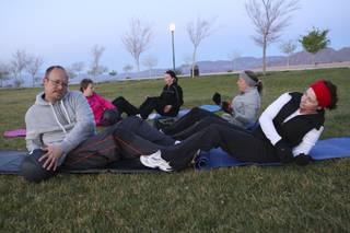 Members of the Boulder City Bootcamp execute medicine ball sit-ups and torso twists Monday morning at Veterans Memorial Park. Clockwise from left: Mike Prahm, Cathy Domzalski, Krista Rendon, Nikki Wendt and Pam Heilman.