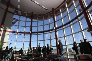 Guests tour the 30,000-square-foot Papillon Airways Boulder City passenger terminal Monday during the grand-opening ceremony.