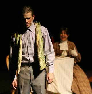 Theater students Tyler Fitzgerald, foreground, and Chloe Weise, from The Meadows School, perform on stage during a dress rehearsal of the musical