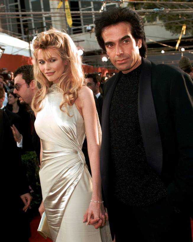 Claudia Schiffer arrives with her boyfriend David Copperfield for the 68th Academy Awards at the Music Center in Los Angeles, Monday, March 25, 1996.