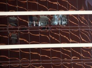 Windows were shattered at the Encore on Thursday after scaffolding struck the resort and two workers were whipped in high winds.