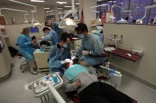 The UNLV Dental School of Medicine faculty and students put on three clinics Saturday to treat local children, veterans, and women referred by Shade Tree Shelter. The clinics are designed for people who do not qualify for Medicaid or are uninsured. The event also provides UNLV dental residents with clinical experience.
