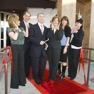 Chrissi Scinta  (left), Jeff Gordon, Dr. Randy Bryson, Dr. Toni Margio, Stephanie Parker and Chistine Castar cut the ribbon marking the grand opening of Dr. Randy Bryson and Dr. Toni Margio's new office Monday, March 23 in Summerlin.