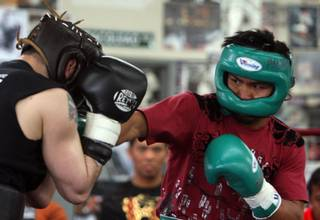 Manny Pacquiao, right, spars with Gary Young as he prepares for his fight with Ricky Hatton at the Wild Card Boxing Club in Hollywood, California March 31, 2009. Pacquiao of Philippines will take on Hatton of England in a 12-round fight at the MGM Grand Garden Arena on May 2.