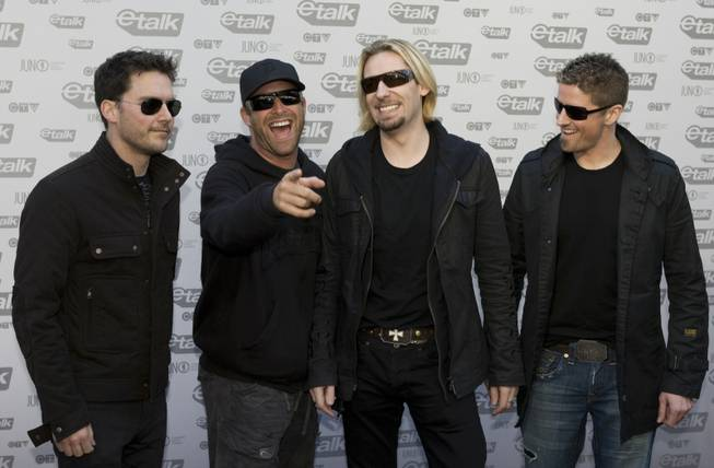 Members of the band Nickelback arrive on the red carpet for the JUNO Awards in Vancouver, Sunday, March 29, 2009.