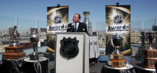 NHL commissioner Gary Bettman speaks to local media among some of hockey's most cherished hardware outside the Ghostbar at the Palms on Apr. 6.
