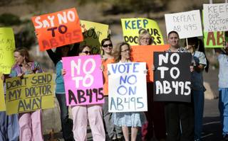 Health advocates rally in opposition of Assembly Bill 495 in front of the Grant Sawyer State Office building in Las Vegas Monday morning.