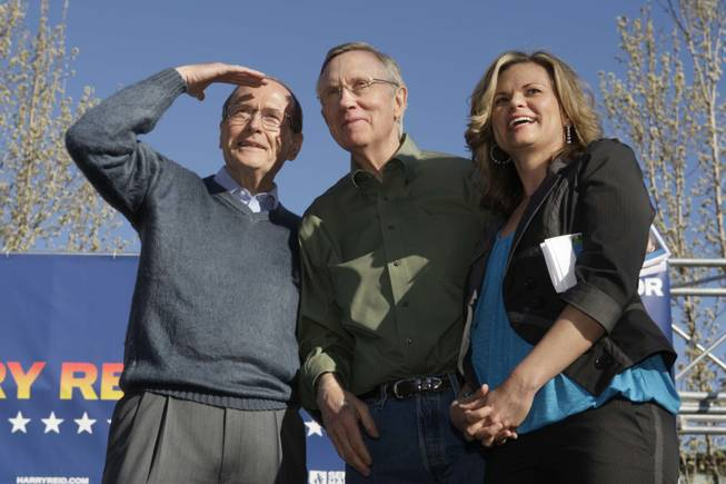Senate Majority Leader Harry Reid is flanked by former U.S. Sen. Richard Bryan and Washoe County Commissioner Kitty Jung as he waits to speak to a rally at UNR in Reno on Tuesday.