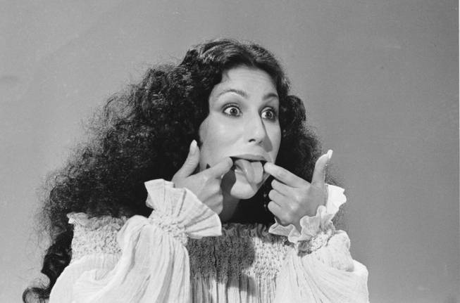 Entertainer Cher sticks her tongue out during taping of a ...