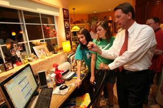 Henderson mayoral candidate Steve Kirk, right, keeps an eye on the election results with his daughters Stacie, center, and Jennifer during his campaign's results party Tuesday.