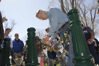 Senate Majority Leader Harry Reid (D-Nev.) attaches a lock to a chain during a campaign stop in Lovelock, Nev., Wednesday, April 7, 2010. The practice is borrowed from a Chinese tradition where locks with the names of couples are locked onto a chain to ensure everlasting love.