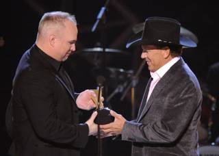 Garth Brooks, left, presents George Strait with the Artist of the Decade Award at the ACM Artist of the Decade All-Star Concert on April 6, 2009, in Las Vegas.