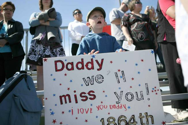 Austin Gibson, 6, holds up a farewell sign for his father, Sgt. Sean Gibson, during a mobilization ceremony for the 1864th Transportation Company Thursday at the Nevada Army National Guard Floyd Edsall Training Center.