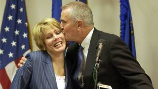 Gov. Jim Gibbons kisses his wife Dawn in August 2003.