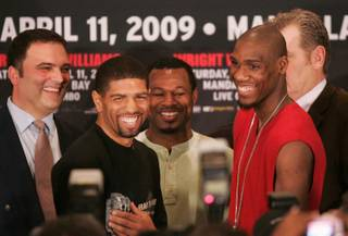 From left, promoter Richard Schaefer, Winky Wright, former boxer Shane Mosley, Paul Williams and Dan Goosen (hidden) smile during a news conference in advance of their Saturday fight Thursday, April 9, 2009 at Mandalay Bay.
