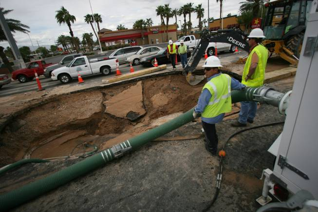 Crews work at the site of a water main break on East Sahara Avenue near Nellis Boulevard.