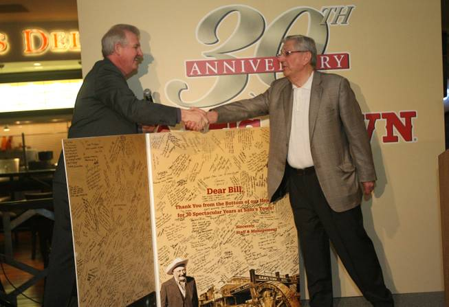 Mike Garms, left, vice president and general manager of Sam's Town, presents Bill Boyd with a greeting card signed by staff and management during a ceremony celebrating the 30th anniversary of the hotel April 11, 2009.