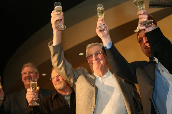 Bill Boyd, executive chairman of Sam's Town, center, shares a toast with, from left, Mike Garms, vice president and general manager; Bob Newman, former general manager; and Keith Smith, president and CEO, during a ceremony celebrating the hotel's 30th anniversary.