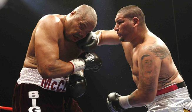 Chris Arreola (right) connects on Jameel McCline, both of the U.S., during a heavyweight fight at the Mandalay Bay Events Center in Las Vegas, Nevada, April 11, 2009.