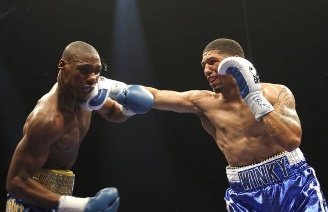 Winky Wright (right) punches at Paul Williams, during a middleweight fight at the Mandalay Bay Events Center April 11, 2009.