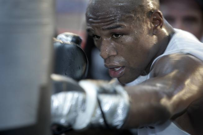 Undefeated boxer Floyd Mayweather Jr. hits a heavy bag during a media workout in his gym Wednesday. Mayweather will fight WBA welterweight champion Shane Mosley for the title at the MGM Grand Garden Arena on May 1.