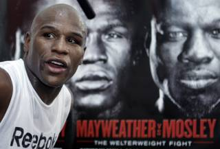 Undefeated boxer Floyd Mayweather Jr. works out at his gym Wednesday. In the background is a poster promoting his upcoming fight against WBA welterweight champion Shane Mosley. Mayweather will fight Mosley for the title at the MGM Grand Garden Arena on May 1.