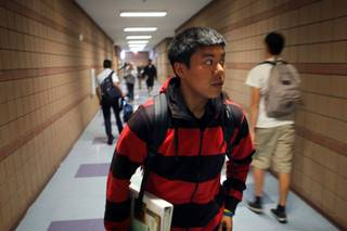 Marlon Magsaysay, a student in the AVID program, makes his way through a hallway at Liberty High School Wednesday, April 15, 2009. The budget cuts are hitting hard at Liberty High. The school will lose 14 teachers, the popular block schedule and the AVID tutoring program. Principal Rosalind Gibson said the school expected to lose a few teachers because of enrollment declines since the campus was built to serve neighborhoods that either never got built or are now largely vacant. But she wasn't prepared for just how deep the cuts would go.
