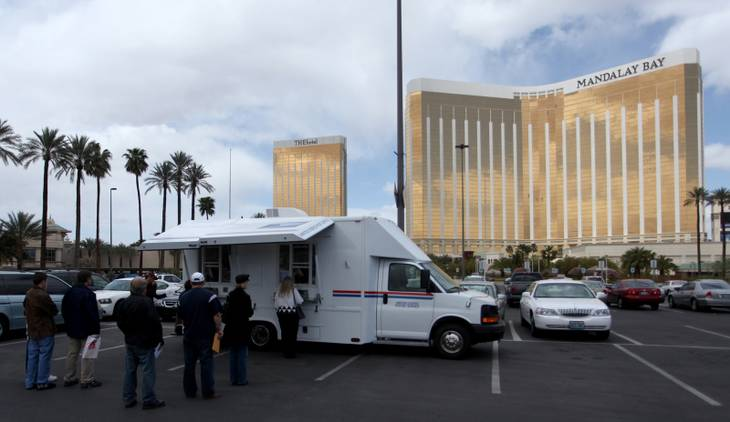 A line forms outside the mobile Post Office stations set up in the Mandalay Bay parking lot on Wednesday. This is the seventh year that Mandalay Bay has offered free ticket vouchers to the Shark Reef Aquarium for those who file tax returns from the site.