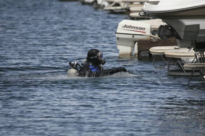 Scuba diver John Weston surveys the underwater damage to docks Wednesday after strong wind gusts hit the Las Vegas Boat Harbor at Lake Mead National Recreation Area on Tuesday night.