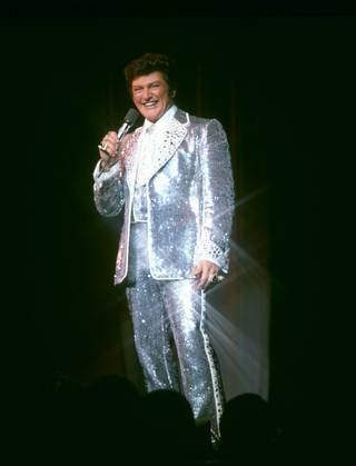 Liberace in one of his glittering costumes.